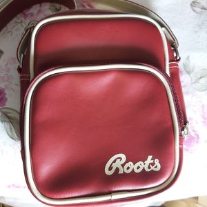 NWOT Roots red bag